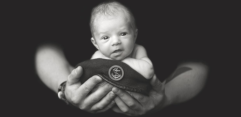 Newborn Baby on Military Cap