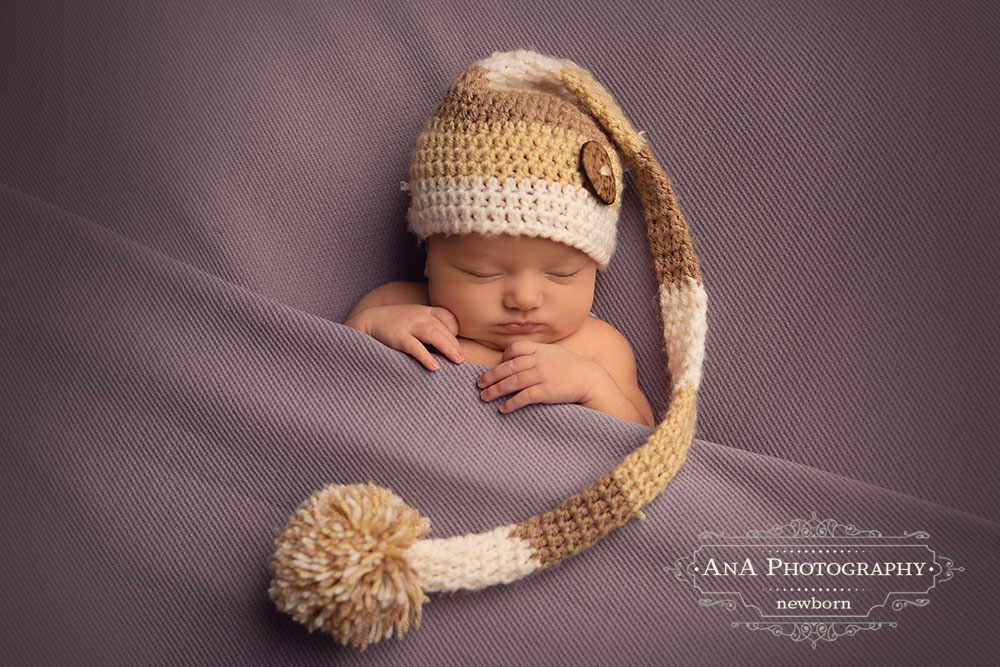 Newborn Baby with hat in Cornwall